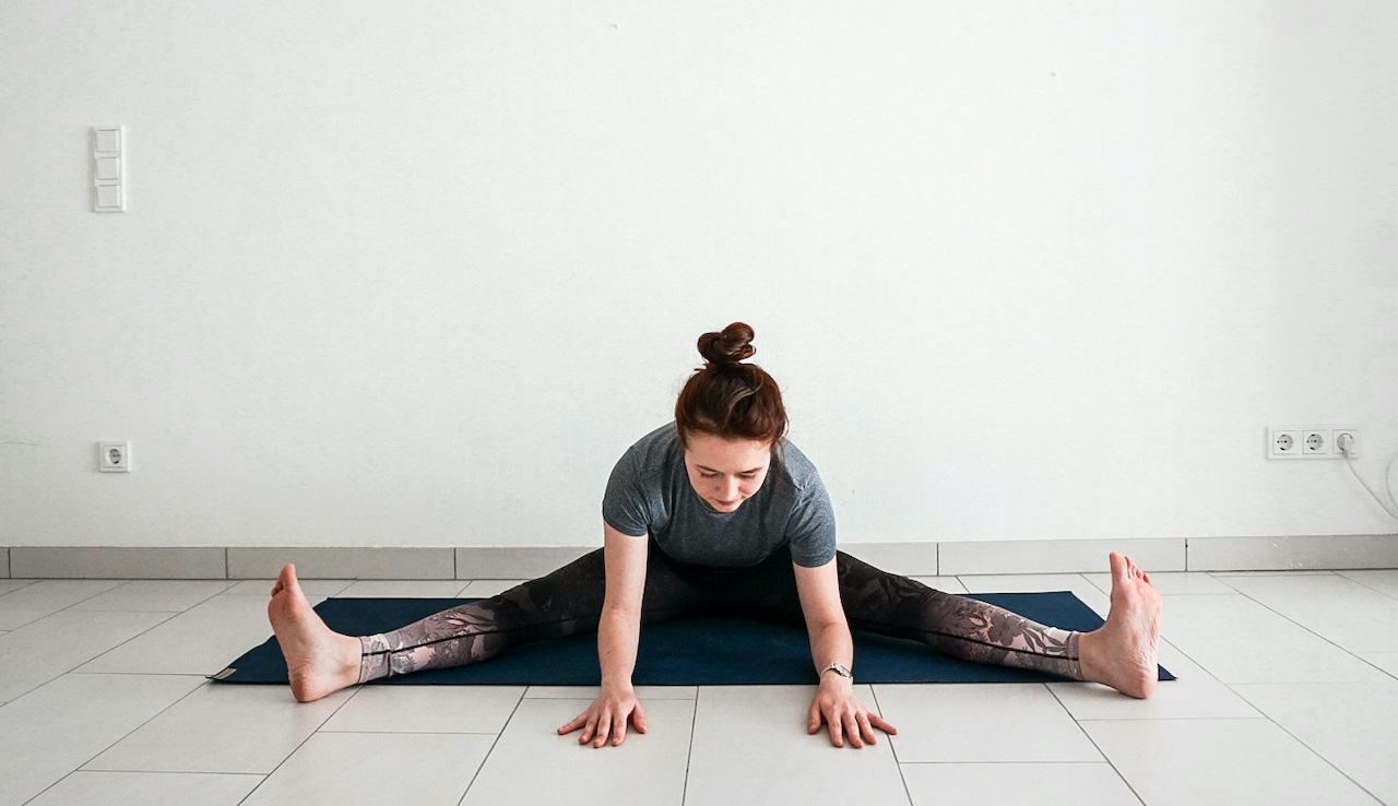 yoga poses for beginners - seated forward fold