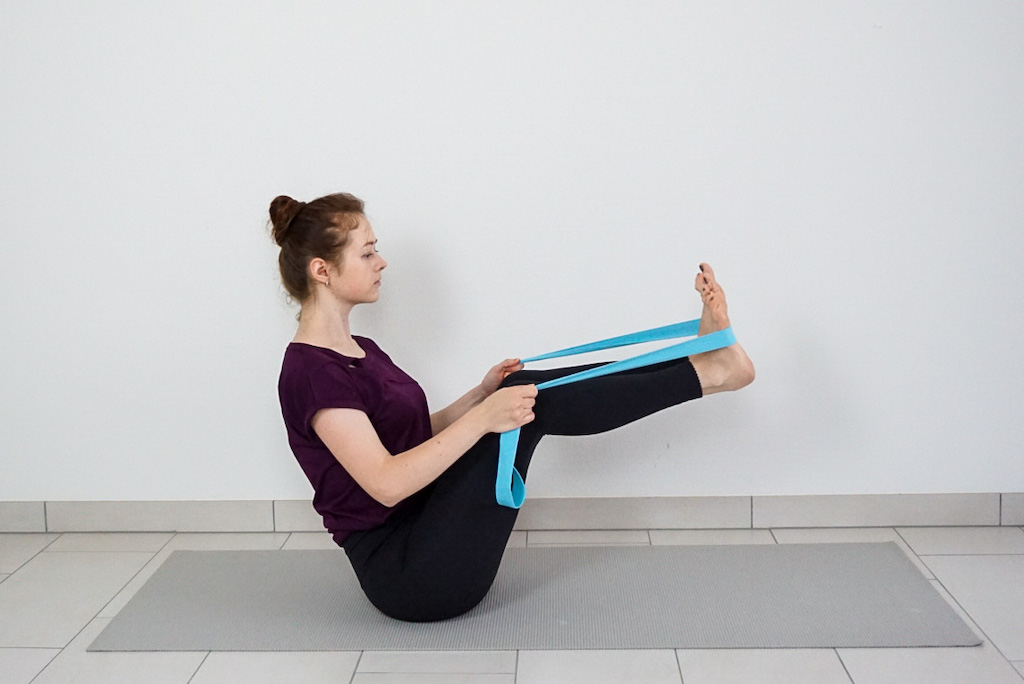 boat pose with yoga strap