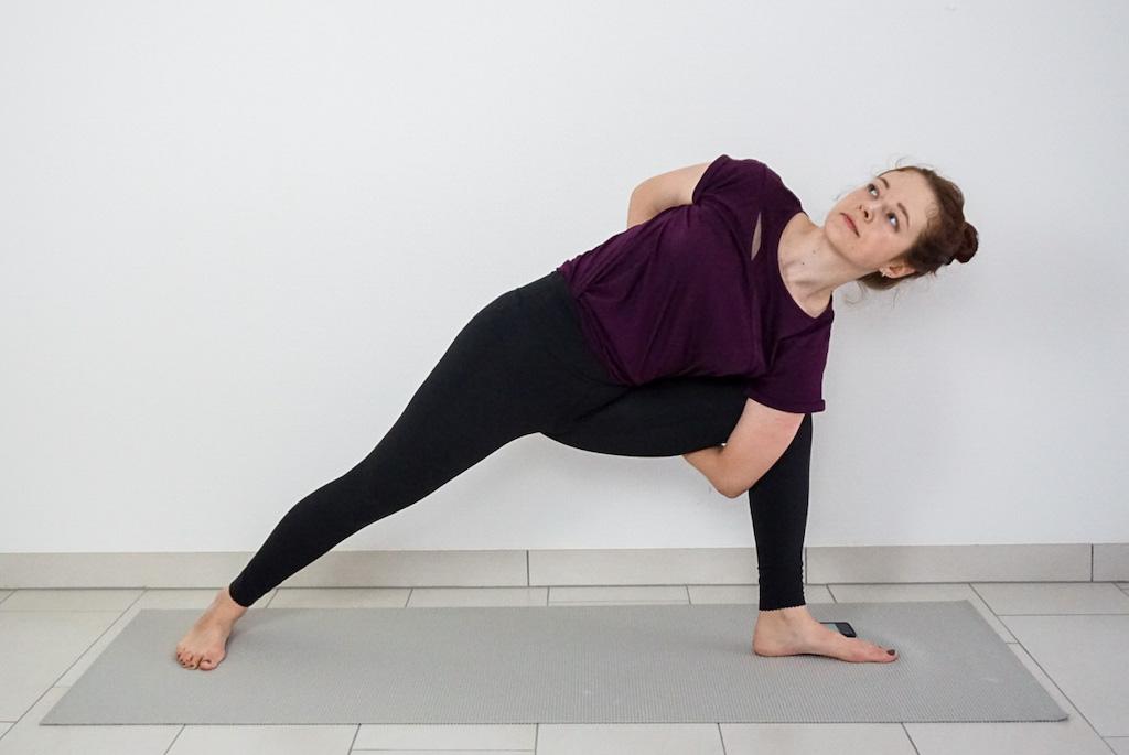 bound yoga pose with yoga strap