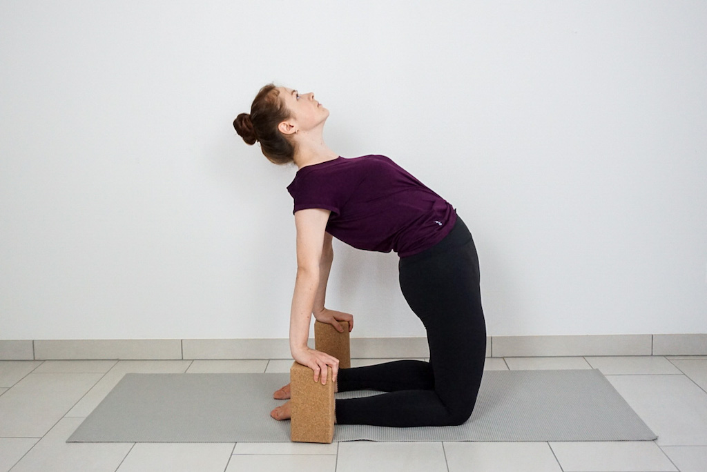 camel pose with yoga blocks
