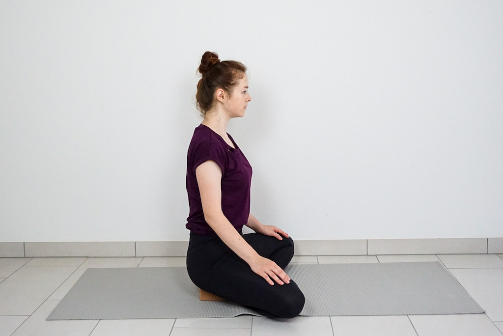easy seated pose with yoga block