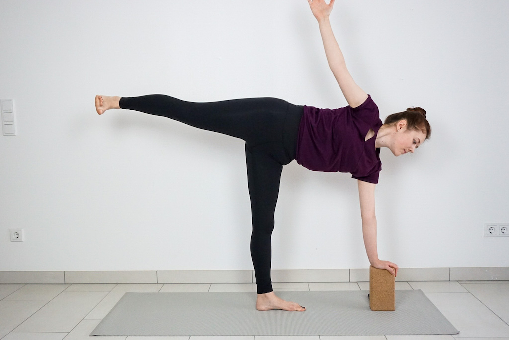 half moon pose with yoga block for beginners