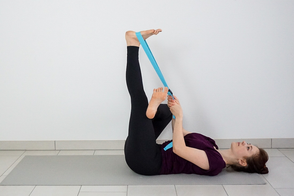 hip stretch for beginners with yoga strap