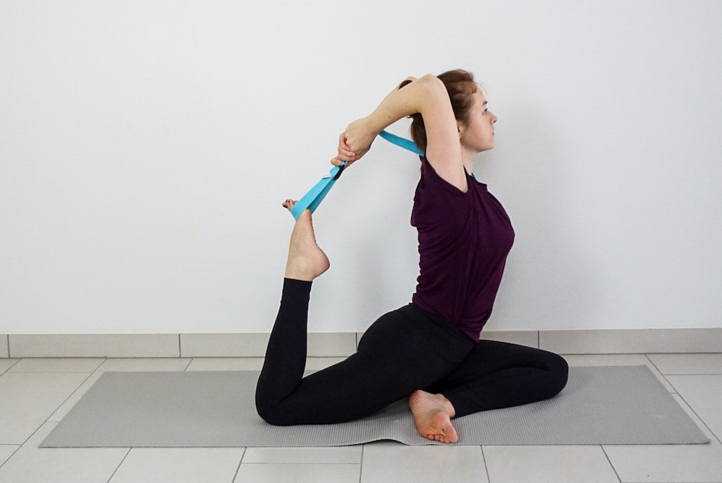 king pigeon pose with yoga strap