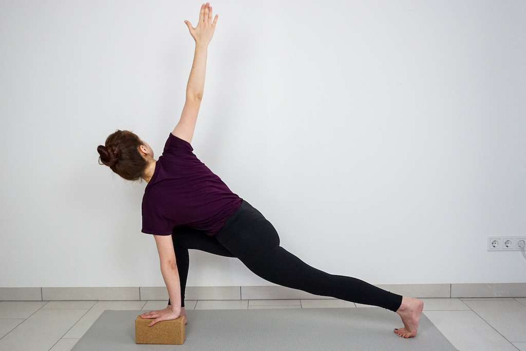 lunge pose twist with yoga block