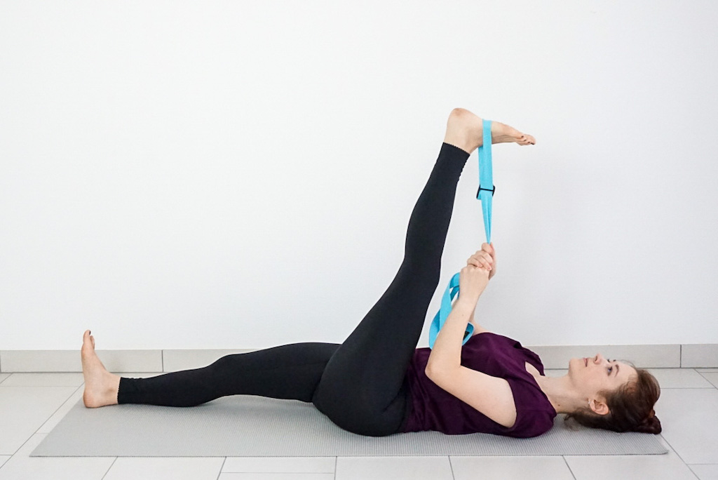 reclined hamstring stretch with yoga strap