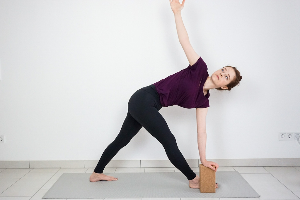revolved triangle pose with yoga block for beginners