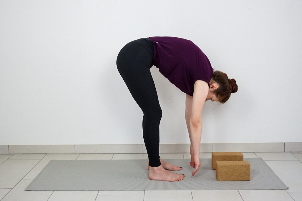 standing forward bend with yoga blocks