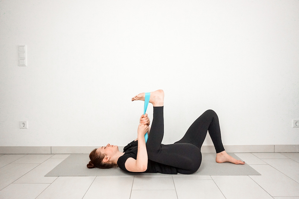 happy baby pose with yoga strap