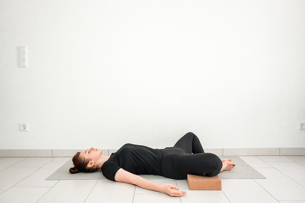 reclined bound angle pose with yoga blocks