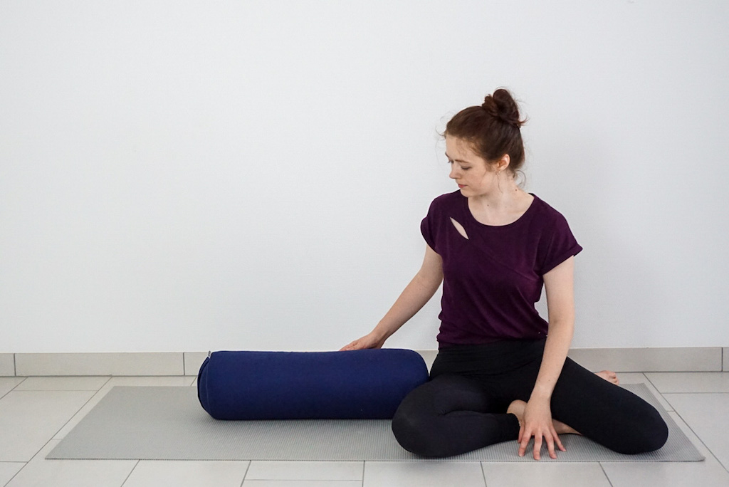 supported twist with yoga bolster