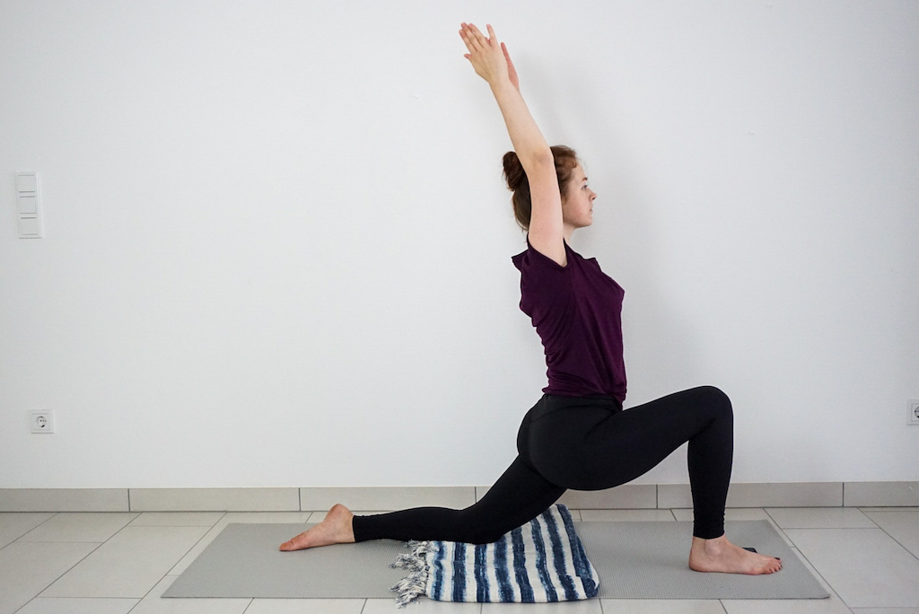 yoga blanket to support knee in low lunge