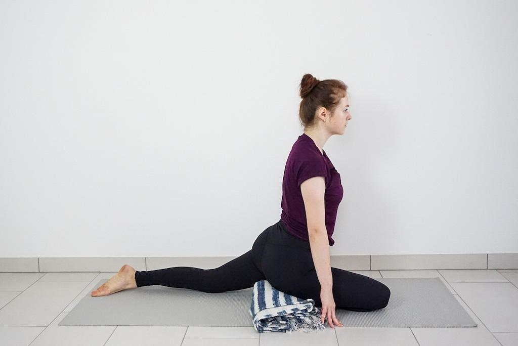 yoga blanket under hips in pigeon pose