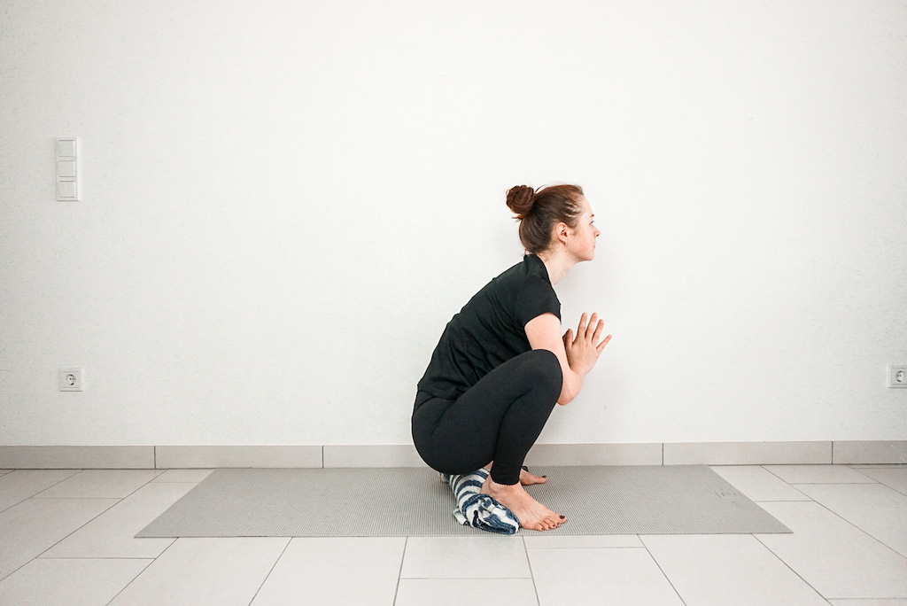yoga squat for beginners with blanker